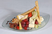 cheese and fruit plate served at sancho panza wine bistro and jazz club restaurant in cabo san lucas, mexico
