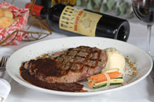 grilled steak served at sancho panza wine bistro and jazz club restaurant in cabo san lucas, mexico