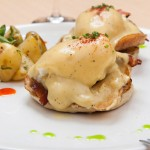 Ukrainian eggs benedict - mounted on English bread, cream cheese, becon, cryspi potatoe, caramelized onions, with hollandaise sauce (poached eggs to taste)
