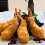 Habaneros Shrimp - wrapped in fish with a squid ink rizzoto, with ajillo salsa.