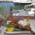 Live Lobster marinade, grilled finished the griddle on your table